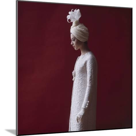 Model Dressed in a White Turban, Gloves, and Brocade Coat by Yves St Laurent, Paris, France, 1962-Paul Schutzer-Mounted Photographic Print