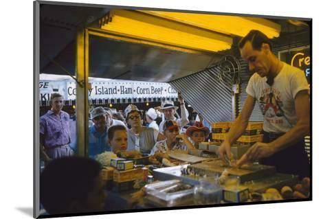 In a Booth at the Iowa State Fair, a Man Demonstrates 'Feemsters Famous Vegetable Slicer', 1955-John Dominis-Mounted Photographic Print