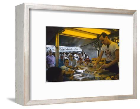 In a Booth at the Iowa State Fair, a Man Demonstrates 'Feemsters Famous Vegetable Slicer', 1955-John Dominis-Framed Art Print