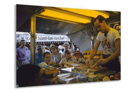 In a Booth at the Iowa State Fair, a Man Demonstrates 'Feemsters Famous Vegetable Slicer', 1955-John Dominis-Metal Print