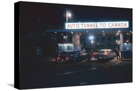 Nighttime View of the Cars at the Entrance to the Detroit-Windsor Tunnel, Detroit, Michigan, 1959-Fritz Goro-Stretched Canvas Print