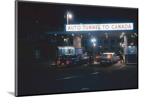 Nighttime View of the Cars at the Entrance to the Detroit-Windsor Tunnel, Detroit, Michigan, 1959-Fritz Goro-Mounted Photographic Print