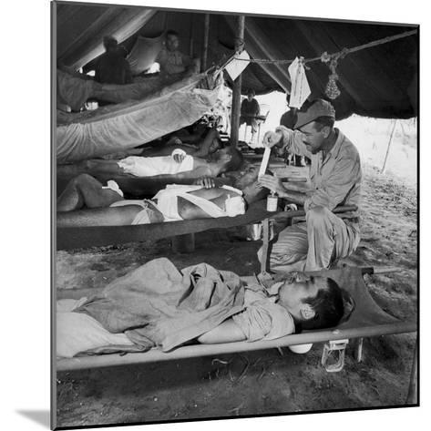 Lew Ayres Treating Wounded Japanese Prisoner in Leyte Cathederal Turned into Hospital, 1944-W^ Eugene Smith-Mounted Photographic Print