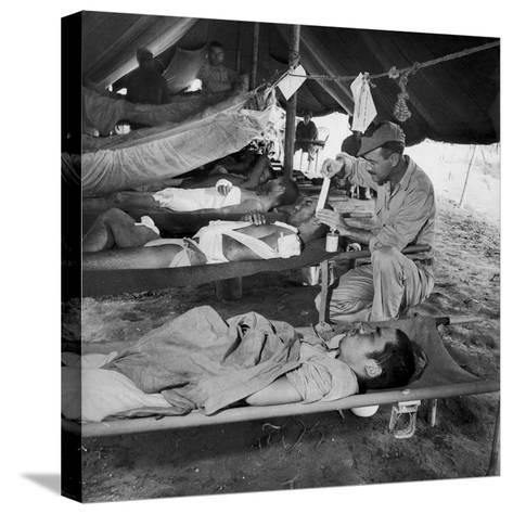 Lew Ayres Treating Wounded Japanese Prisoner in Leyte Cathederal Turned into Hospital, 1944-W^ Eugene Smith-Stretched Canvas Print