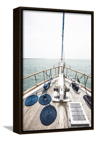 The Bow of a Wooden Sailboat on the Ocean in Panama-Jonathan Kingston-Framed Canvas Print