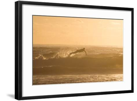 A Surfer Dives over a Wave on Praia Da Joaquina Beach on Florianopolis Island-Alex Saberi-Framed Art Print