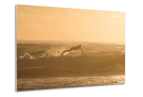 A Surfer Dives over a Wave on Praia Da Joaquina Beach on Florianopolis Island-Alex Saberi-Metal Print
