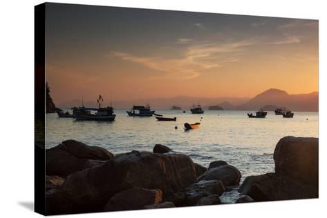 Fishermen's Boats Float Off the Coast of Praia Da Picinguaba, Ubatuba, Brazil-Alex Saberi-Stretched Canvas Print