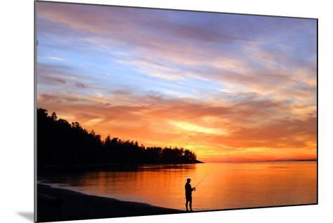 Silhouette of Man Fishing on West Beach on Whidbey Island-Donna O'Meara-Mounted Photographic Print