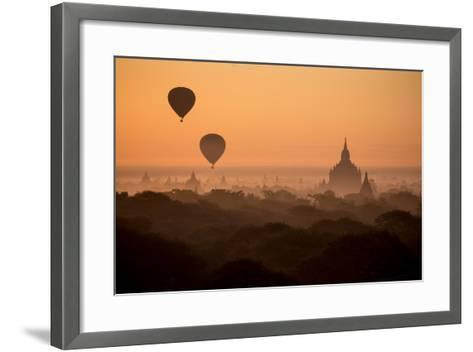 Hot Air Balloons Float Above the Terraces of a Buddhist Temple in Bagan-Cory Richards-Framed Art Print