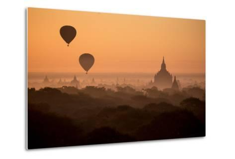 Hot Air Balloons Float Above the Terraces of a Buddhist Temple in Bagan-Cory Richards-Metal Print