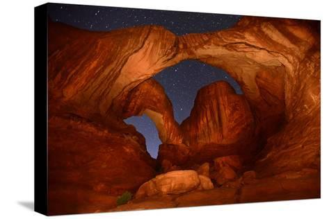 Double Arch at Night in Arches National Park-Raul Touzon-Stretched Canvas Print
