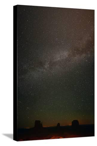 Milky Way Above Monument Valley-Raul Touzon-Stretched Canvas Print