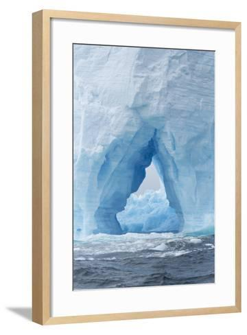 A Natural Arch Formation Inside a Tabular Iceberg-Jeff Mauritzen-Framed Art Print