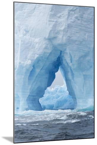 A Natural Arch Formation Inside a Tabular Iceberg-Jeff Mauritzen-Mounted Photographic Print