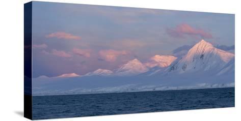 Snowcapped Mountain Along the Gerlache Strait, Antarctica-Jeff Mauritzen-Stretched Canvas Print