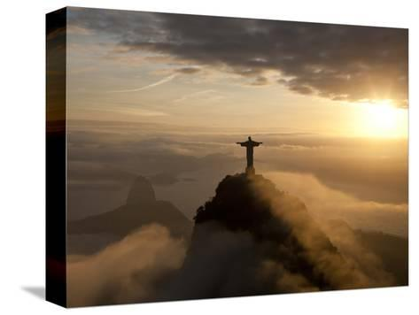 Statue of Jesus, known as Cristo Redentor (Christ the Redeemer), on Corcovado Mountain in Rio De Ja-Peter Adams-Stretched Canvas Print