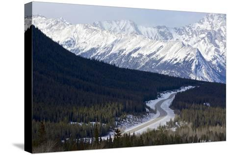 Canada, Alberta, Kootenay Plains. Road Through Mountain Landscape-Jaynes Gallery-Stretched Canvas Print