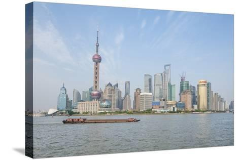 Pudong District Skyline with Shipping on the Huangpu River, Shanghai, China-Michael DeFreitas-Stretched Canvas Print