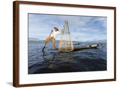 Myanmar, Inle Lake. Young Fisherman Demonstrates a Traditional Rowing Technique-Brenda Tharp-Framed Art Print