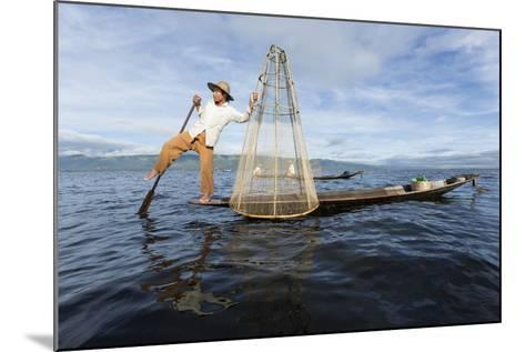 Myanmar, Inle Lake. Young Fisherman Demonstrates a Traditional Rowing Technique-Brenda Tharp-Mounted Photographic Print