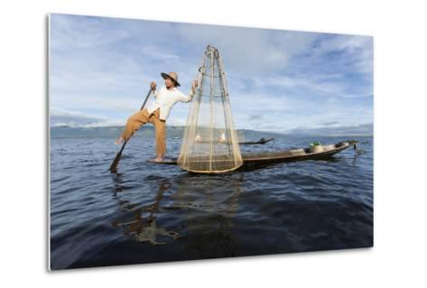 Myanmar, Inle Lake. Young Fisherman Demonstrates a Traditional Rowing Technique-Brenda Tharp-Metal Print