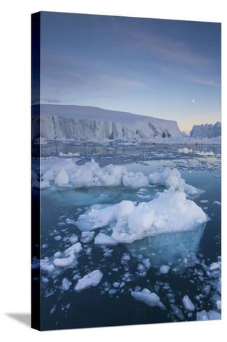 Greenland, Disko Bay, Ilulissat, Floating Ice at Sunset with Moonrise-Walter Bibikow-Stretched Canvas Print