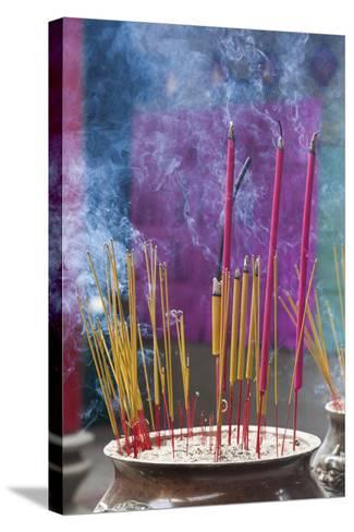 Vietnam, Ho Chi Minh City. Cholon, Chinatown Area, Thien Hau Pagoda, Burning Incense-Walter Bibikow-Stretched Canvas Print