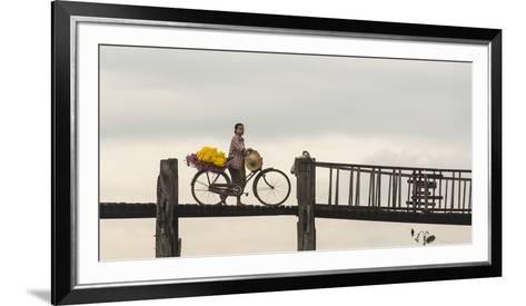 Myanmar, Mandalay. Woman Walks Her Flower-Laden Bicycle across U Bein Bridge-Brenda Tharp-Framed Art Print