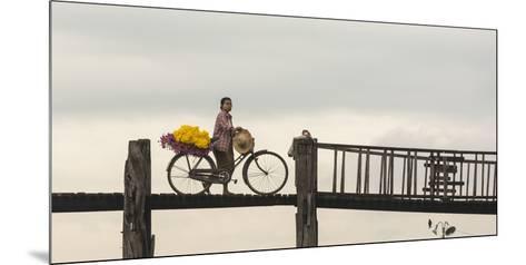 Myanmar, Mandalay. Woman Walks Her Flower-Laden Bicycle across U Bein Bridge-Brenda Tharp-Mounted Photographic Print