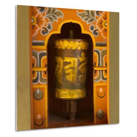 Bhutan. Prayer Wheel Spins in the Wall of a Temple-Brenda Tharp-Metal Print