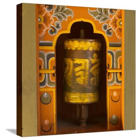 Bhutan. Prayer Wheel Spins in the Wall of a Temple-Brenda Tharp-Stretched Canvas Print