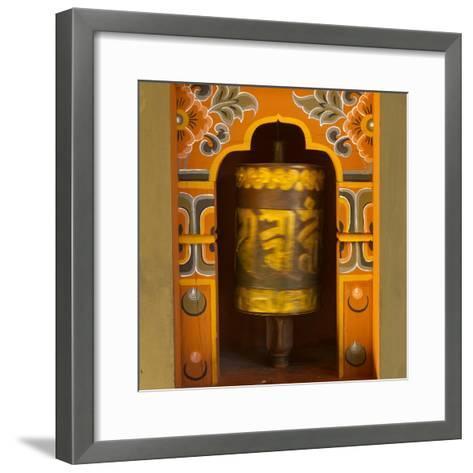 Bhutan. Prayer Wheel Spins in the Wall of a Temple-Brenda Tharp-Framed Art Print