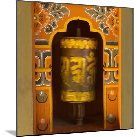 Bhutan. Prayer Wheel Spins in the Wall of a Temple-Brenda Tharp-Mounted Photographic Print