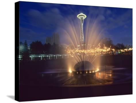 Wa, Seattle, International Fountain with Holiday Lights and the Space Needle-Jamie And Judy Wild-Stretched Canvas Print