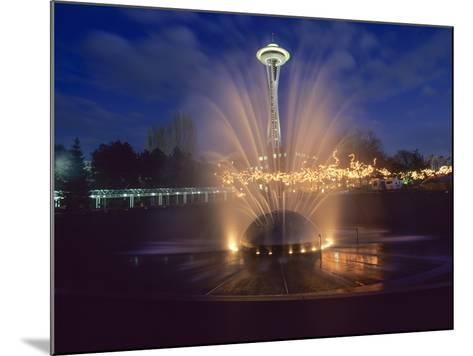 Wa, Seattle, International Fountain with Holiday Lights and the Space Needle-Jamie And Judy Wild-Mounted Photographic Print