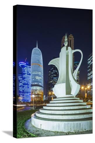 Qatar, Doha, Doha Bay, West Bay Skyscrapers, Dusk, with Large Coffeepot Sculpture-Walter Bibikow-Stretched Canvas Print