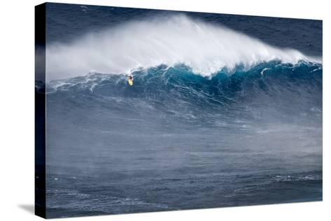 Hawaii, Maui. Kai Lenny Stand Up Paddle Board Surfing Monster Waves at Pe'Ahi Jaws-Janis Miglavs-Stretched Canvas Print