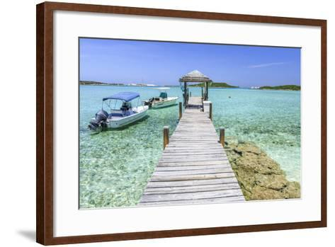 A Wood Pier Leads to Moored Boats and Clear Tropical Waters Near Staniel Cay, Exuma, Bahamas-James White-Framed Art Print