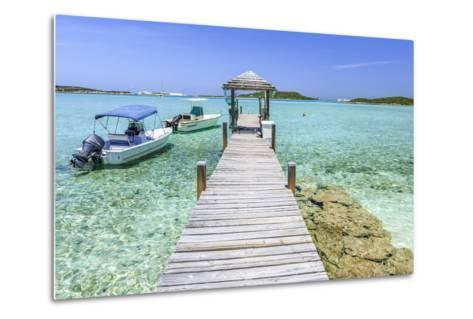 A Wood Pier Leads to Moored Boats and Clear Tropical Waters Near Staniel Cay, Exuma, Bahamas-James White-Metal Print