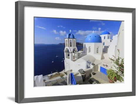 Blue Roofed Churches and Homes are Everywhere on the Island. Santorini. Greece-Tom Norring-Framed Art Print