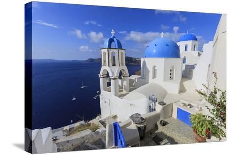 Blue Roofed Churches and Homes are Everywhere on the Island. Santorini. Greece-Tom Norring-Stretched Canvas Print