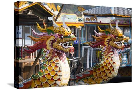 Vietnam, Hue. Dragon Excursion Boats, Perfume River-Walter Bibikow-Stretched Canvas Print