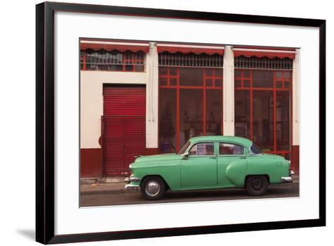 Cuba, Havana. Green Car, Red Building on the Streets-Brenda Tharp-Framed Art Print