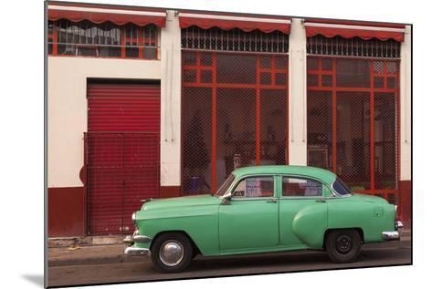 Cuba, Havana. Green Car, Red Building on the Streets-Brenda Tharp-Mounted Photographic Print