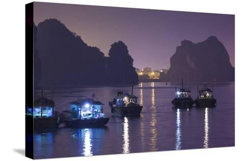 Vietnam, Halong City, Halong Bay Fishing Boats, Dusk-Walter Bibikow-Stretched Canvas Print