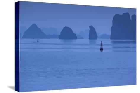 Vietnam, Halong City, Halong Bay Rocks, Dusk-Walter Bibikow-Stretched Canvas Print