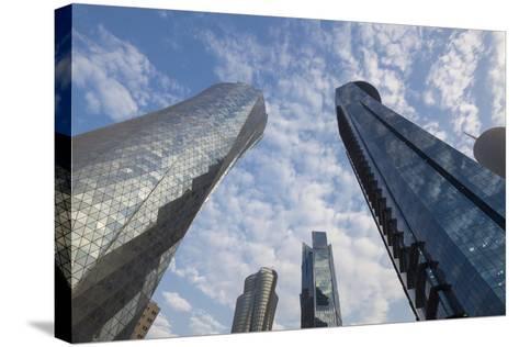 Qatar, Doha, Doha Bay, West Bay Skyscrapers, Dusk-Walter Bibikow-Stretched Canvas Print