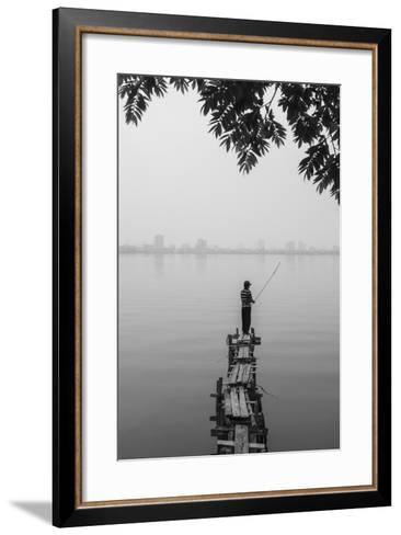 Vietnam, Hanoi. Tay Ho, West Lake, Fisherman-Walter Bibikow-Framed Art Print