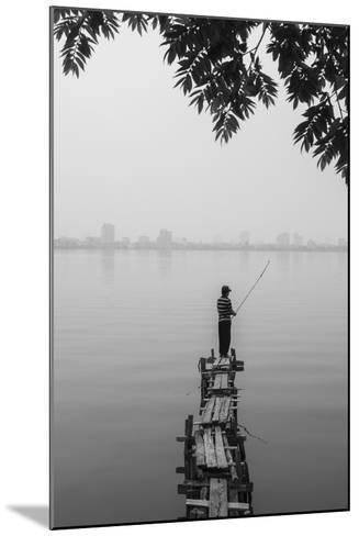 Vietnam, Hanoi. Tay Ho, West Lake, Fisherman-Walter Bibikow-Mounted Photographic Print